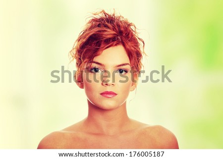 Close-up portrait of sexy caucasian young redhead woman - stock photo
