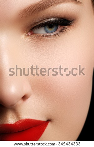 Close-up portrait of sexy caucasian young woman model with glamour red lips make-up, eye arrow makeup, purity complexion. Perfect clean skin. Retro beauty style - stock photo