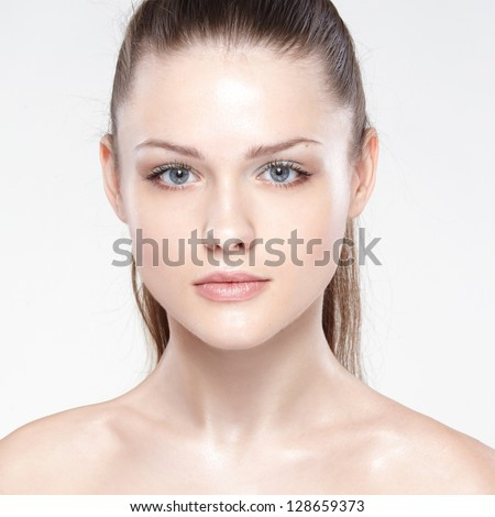 Close-up portrait of sexy caucasian young woman with beautiful blue eyes. On white background - stock photo