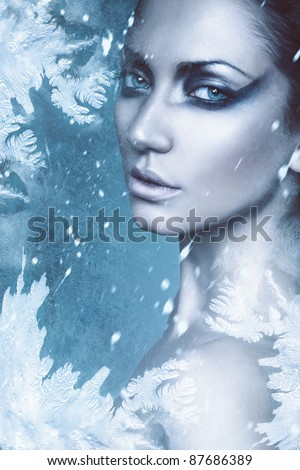 close up portrait of sexy winter woman in snow - stock photo