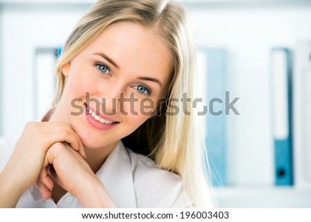 Close up portrait of smiling business woman - stock photo