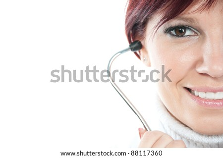 Close-up portrait of smiling female doctor with stethoscope, white background, copyspace - stock photo