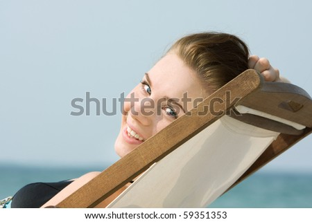 close up portrait of smiling girl on beach - stock photo