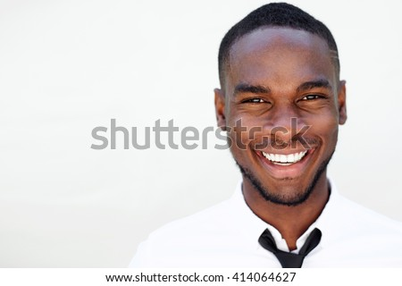 Close up portrait of smiling handsome young african man on white background - stock photo