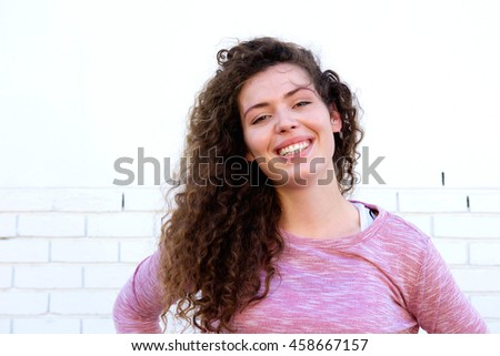 Close up portrait of smiling teen girl with confidence - stock photo
