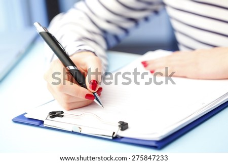 Close-up portrait of student fill the test while sitting at desk at university.  - stock photo