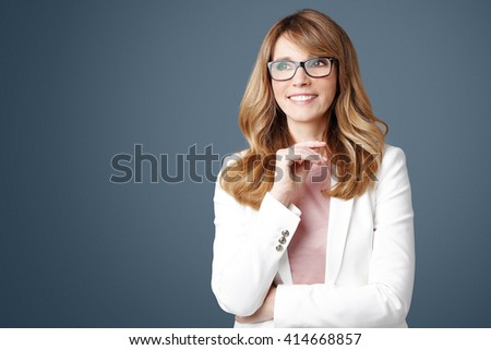 Close-up portrait of successful businesswoman standing at isolated background. - stock photo