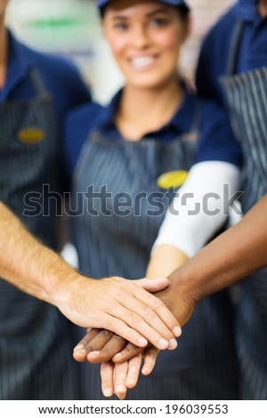 close up portrait of supermarket workers hands together - stock photo