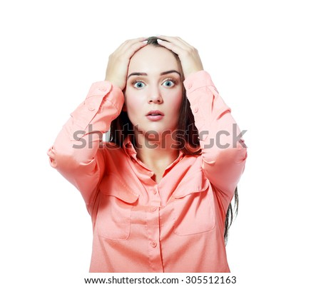 Close-up portrait of surprised beautiful girl holding her head in amazement and open-mouthed. Over white background. - stock photo