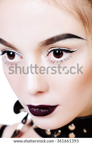 Close-up portrait of the attractive young woman. Cosmetics, make-up. Isolated over white. - stock photo