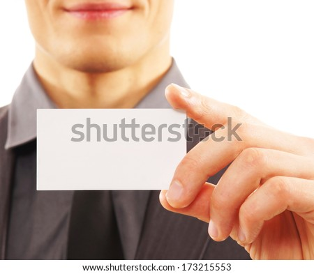 Close-up portrait of the businessman with a visit card - stock photo
