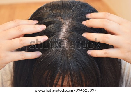 Close up portrait of the hair of a forty years old woman - stock photo