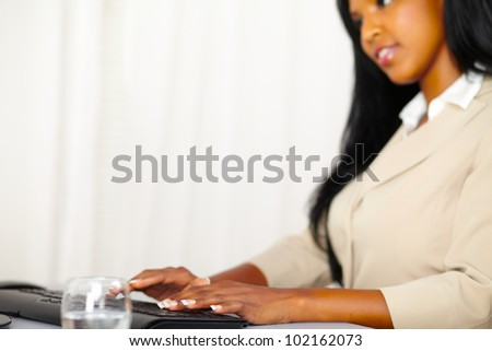 Close up portrait of the hands of a professional woman working on computer - stock photo