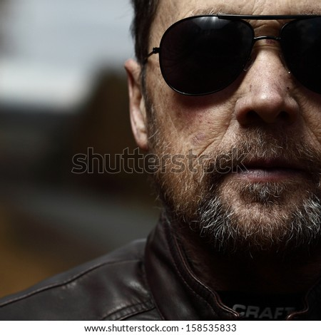 Close up portrait of the mature man with black glasses - stock photo