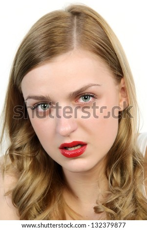 Close up portrait of the offended beautiful blonde woman. - stock photo