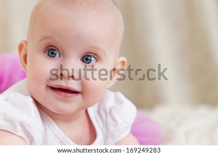 Close up portrait of the six month old baby indoor - stock photo