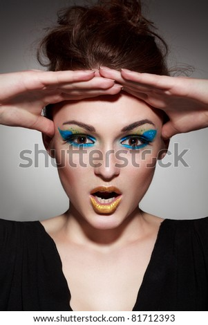 Close-up portrait of the surprised lady with good makeup - stock photo