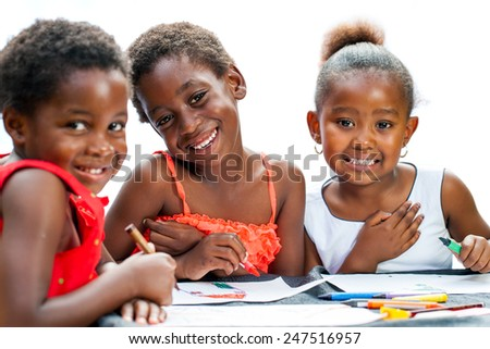Close up portrait of three cute some African girlfriends drawing together.Isolated on white background. - stock photo
