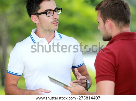 close up portrait of Two college students studying together at college park - stock photo