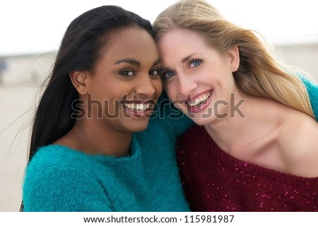 Close up portrait of two happy women smiling - stock photo