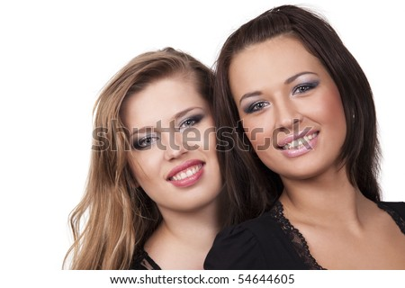 Close-up portrait of two voluptuous girls - stock photo