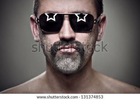 close-up portrait of unshaven man in sunglasses - stock photo