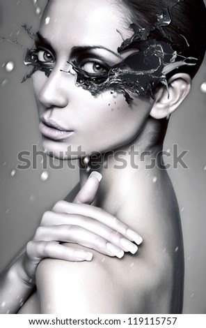 close up portrait of winter woman with blue splash mask - stock photo