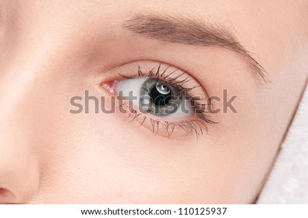 Close-up portrait of woman eye with perfect health skin of face. Isolated on white - stock photo