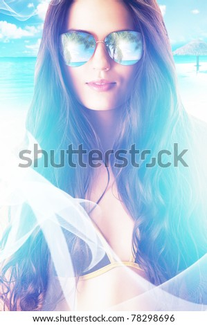 close-up portrait of woman in sunglasses on the beach - stock photo