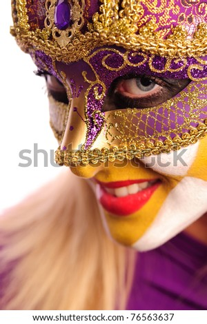 Close-up portrait of woman in violet mask, isolated on white - stock photo