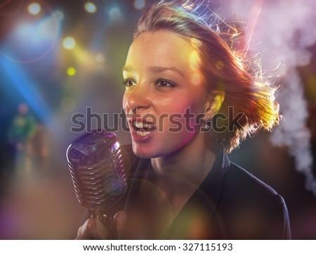 Close-up portrait of woman singer - stock photo