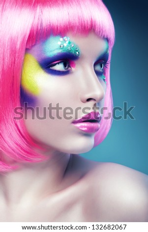 close-up portrait of woman with pink hair - stock photo