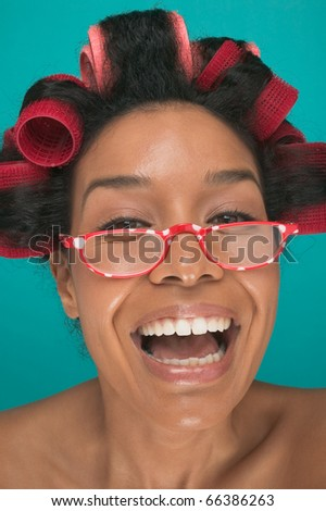 Close up portrait of woman with rollers in hair - stock photo