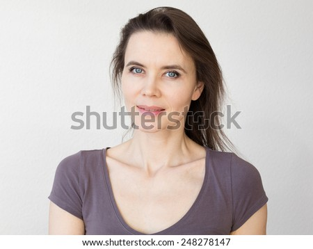 Close-up portrait of woman 30-40 years old - stock photo