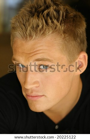 Close-up portrait of young attractive male model - stock photo