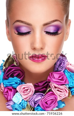 Close-up portrait of young beautiful blond girl with closed eyes and stylish violet make-up - stock photo