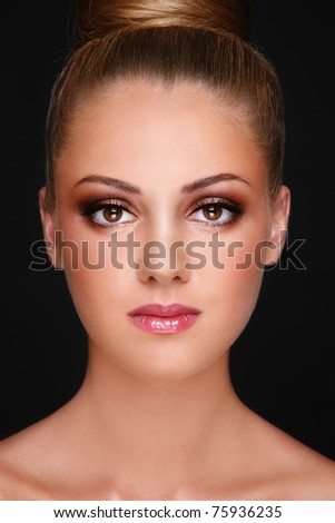 Close-up portrait of young beautiful blond girl with stylish trendy make-up - stock photo