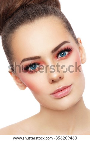 Close-up portrait of young beautiful blue-eyed woman with stylish sunny make-up over white background - stock photo