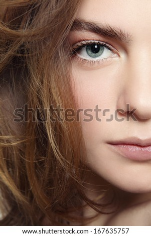 Close-up portrait of young beautiful girl with clean make-up  - stock photo