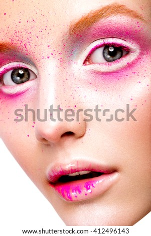 Close-up portrait of young beautiful girl with pink make-up - stock photo
