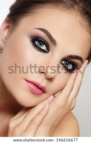 Close-up portrait of young beautiful stylish woman with smoky eyes - stock photo