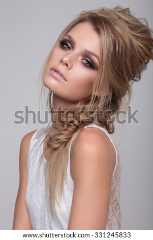 Close-up portrait of young beautiful stylish woman with smoky eyes. - stock photo