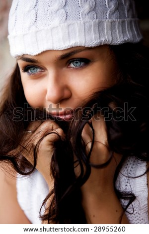 Close-up portrait of young beautiful woman in white hat - stock photo