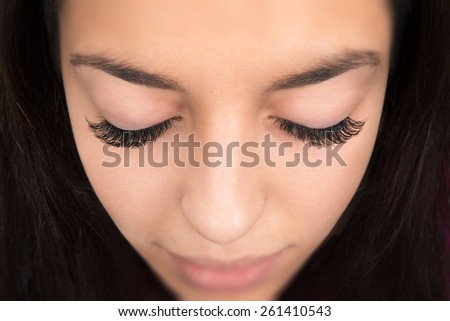 close-up portrait of young beautiful woman's closed eye - stock photo
