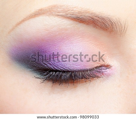 close-up portrait of young beautiful woman's eye zone make-up - stock photo