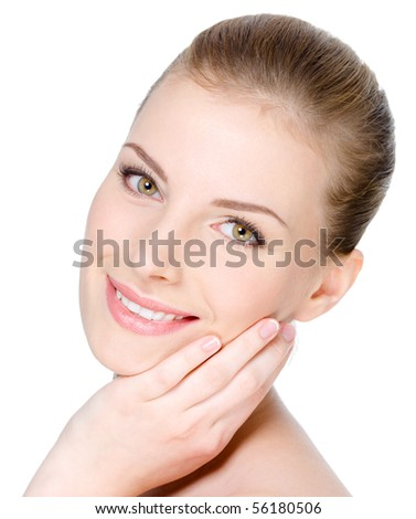 Close-up portrait of young beautiful woman's face with happy cheerful smile on it - white background - stock photo