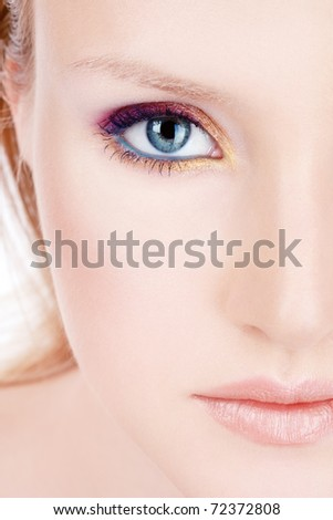 Close-up portrait of young beautiful woman with bright makeup - stock photo