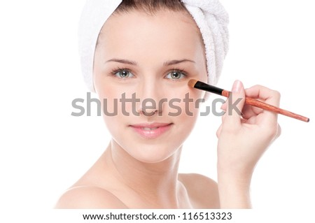 Close-up portrait of young beautiful woman with brush for make-up. Eye zone - stock photo
