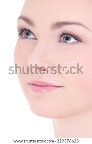close up portrait of young beautiful woman with long eyelashes and perfect skin isolated on white background - stock photo