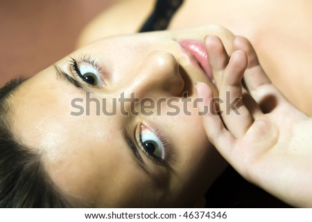 close-up portrait of young beautiful woman with pure healthy skin and large eyes - stock photo
